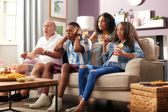 Family watching sport